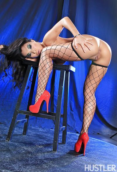 Asian babe model Asa Akira posing in bodice and fishnet stockings