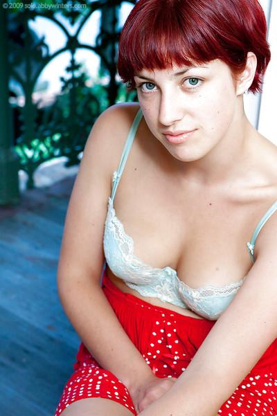 Short haired redhead Tinneale exposing her all natural breasts