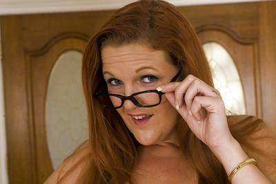sassy MILF in glasses Kitty Lynxxx uncovering her jaw-dropping gorgeous curves