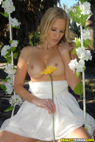Milf babe Brianna Ray takes part in an outdoor posing scene