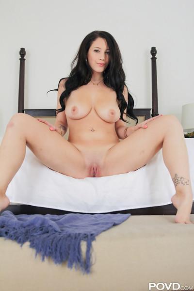 Long-haired brunette Noelle Easton spreading her legs and masturbating