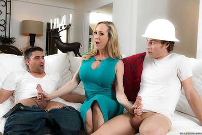 Busty blonde MILF Brandi Love giving big cocks blowjobs in MMF threesome
