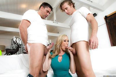 Busty blonde MILF Brandi Love giving big cocks blowjobs in MMF threesome