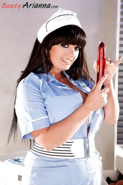 Chesty stocking attired MILF nurse Arianna Sinn toying shaved pussy