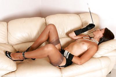 Mature MILF in nylons and garters enjoying a smoke in long black gloves