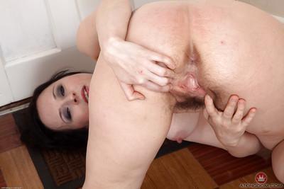 Brunette solo girl in high heels spreading hairy MILF vagina