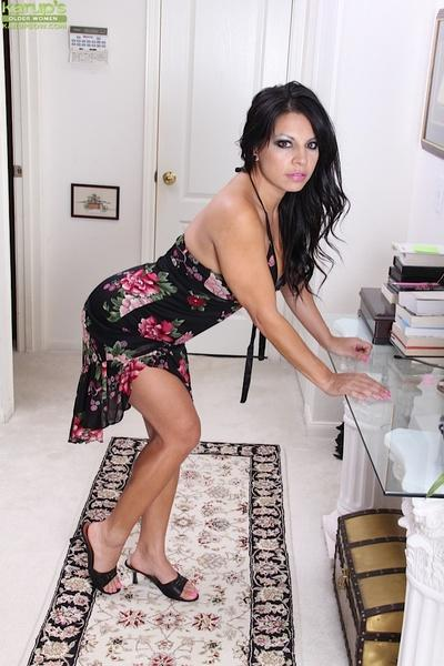 Sweet brunette latina milf Eva showing her ass, titties and pussy