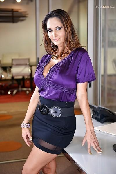 Buxom Latina MILF Ava Addams letting her big knockers loose at work