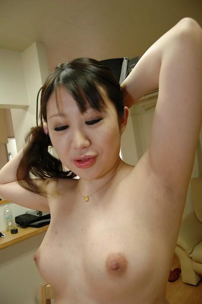 Chubby asian MILF with perky tits taking shower and rubbing her soapy curves