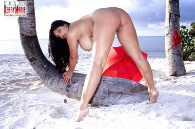 Brunette beach bunny Kerry Marie exposing large pornstar tits and ass