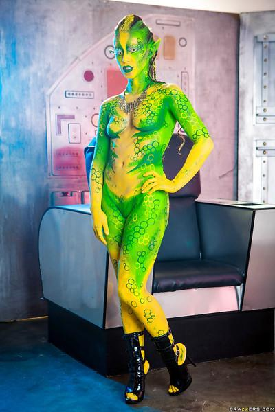 Kinky cosplay chick Tiffany Doll posing in body paint uniform and spreading