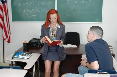 Redhead MILF Shannon sucking her student