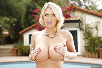 Milf babe Leigh Darby demonstrates her big tits outdoor in lingerie