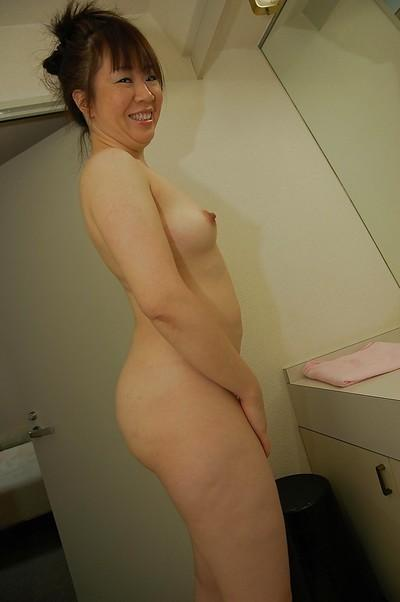 Asian MILF Junko Takeyama taking shower and teasing her hairy gash