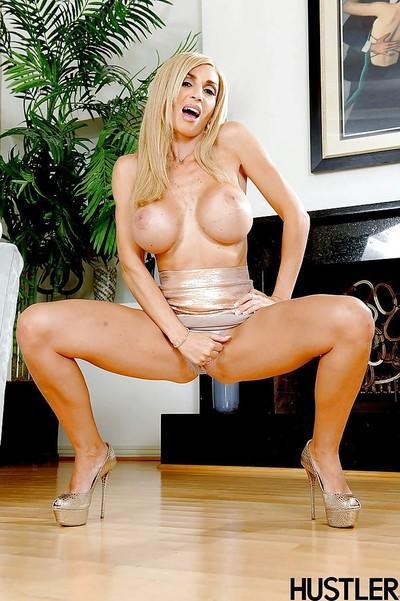 Buxom blonde Italian MILF pornstar Evita Pozzi flaunting massive tits