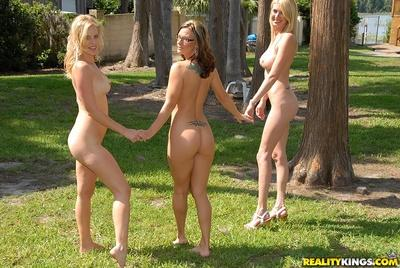 Three lesbian MILFs flaunting nude outdoor