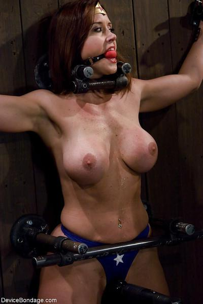 Christina Carter plays Wonder Woman during kinky Device Bondage porn shoot