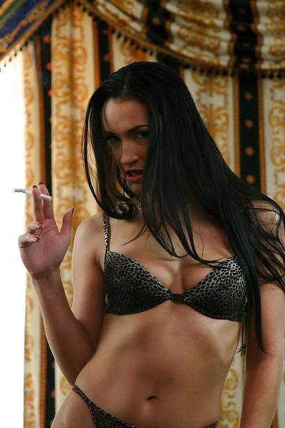 Smoking european MILF Sandra Kay performs a steamy solo scene