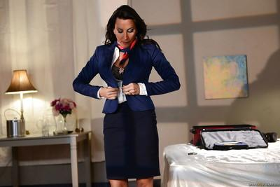 Outstanding big tit stewardess Lezley Zen getting dressed for work