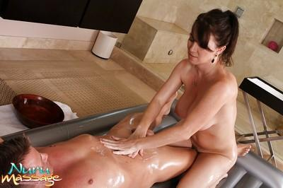 Winning beautiful massage worker Rayveness is oiled and rammed