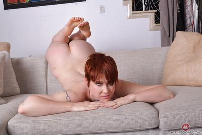Short haired redheaded mom Lily Cade revealing hairy bush under bikini