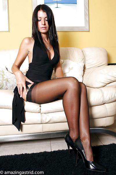 European brunette MILF posing seductively in black nylons and garters