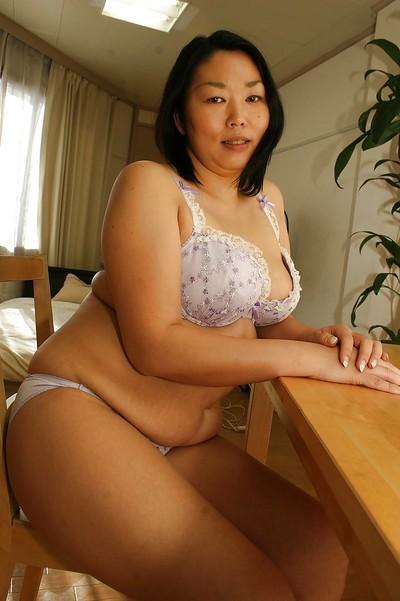 Innocent Asian milf Tamaki Shimai demonstrates her boobies on cam