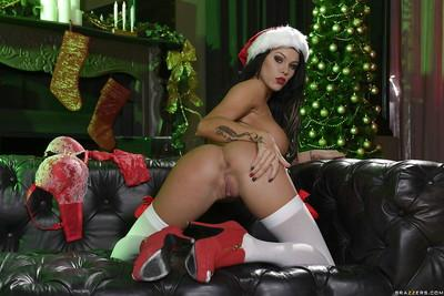 Buxom brunette wife Peta Jensen posing in Santa outfit for Christmas pics