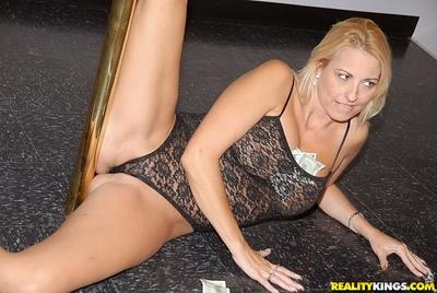 Blonde MILF on high heels dancing striptease and exposing her big tits