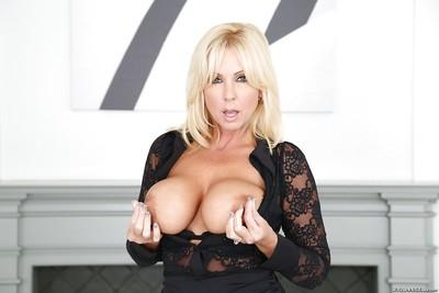 Busty blonde MILF Dee Siren showing off sexy older woman legs