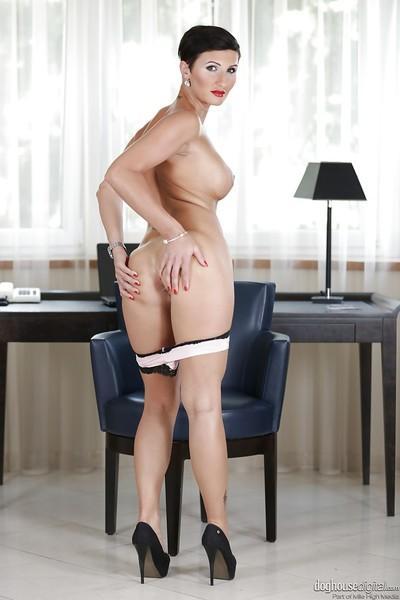 European brunette Gabrielle Gucci demonstrates her milf big tits