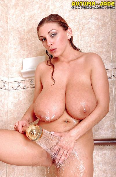 Curvy MILF pornstar Autumn Jade getting huge natural boobs wet in shower