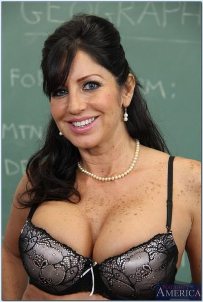 Curvaceous mature teacher Tara Holiday stripping in the classroom