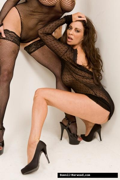 Dannii Harwood and Linsey Dawn Mckenzie are posing in high heels