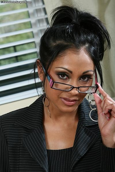 Busty MILF in glasses gets naughty and strips to play with her pussy
