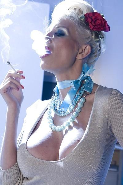 Steamy blonde MILF Puma Swede smoking and revealing her goods