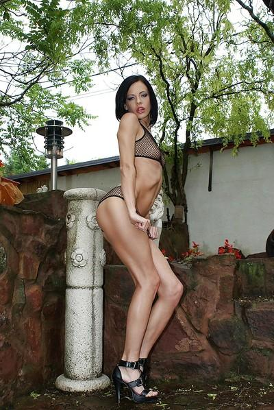 Graceful raven-haired hottie posing in sheer outfit outdoor