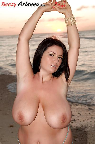 Brunette plumper Arianna Sinn unleashing huge all natural breasts at beach