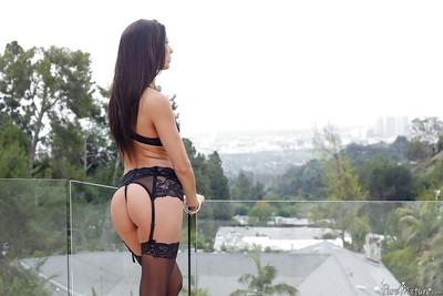 Top babe model Alexa Tomas poses in sexy black stockings and heels outdoors
