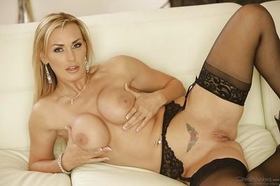 European milf Tanya Tate is posing in the sweetest stockings