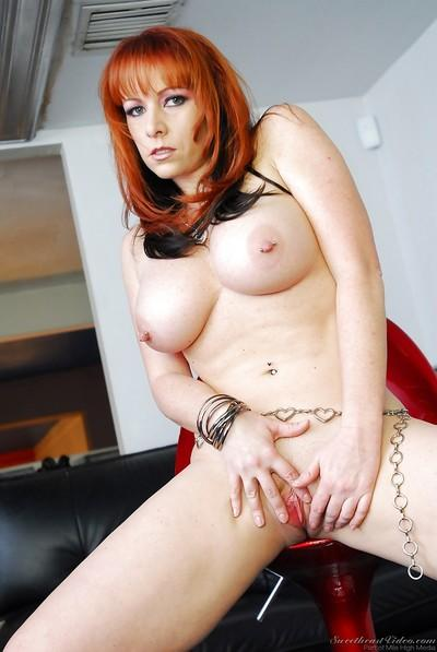 Busty redhead MILF in high-heeled boots undressing and spreading her legs
