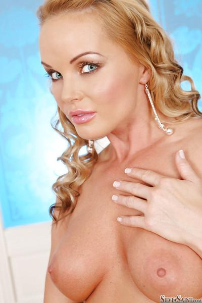 Loveable Silvia Saint taking off her dress and revealing her pink pussy