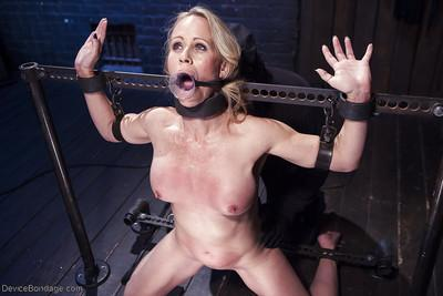 Blonde MILF Simone Sonay gets her bare ass whipped in restraints