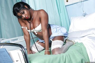 Raunchy ebony nurse with pigtails Jasmine Webb taking off her uniform