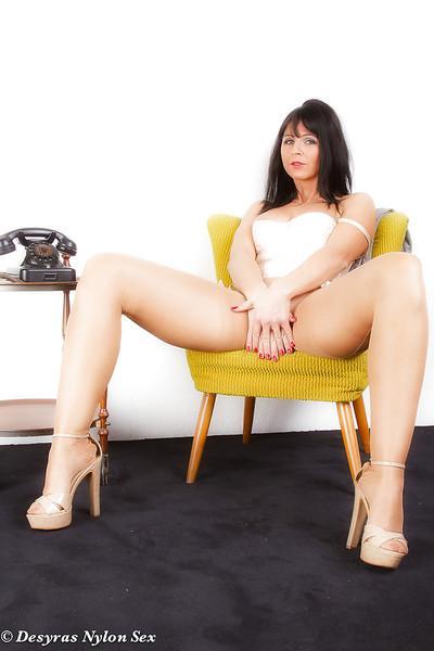 Brunette mom Desyra Noir exposing shaved pussy for masturbation