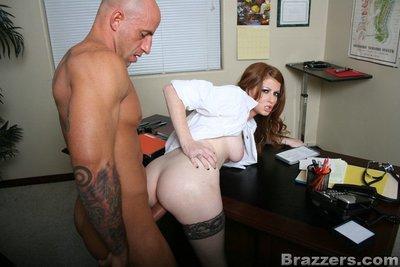 MILF babe Nikki Rhodes strips off uniform and enjoys ass fucking