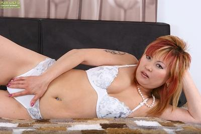 Sassy asian MILF taking off her lingerie and exposing her pink twat