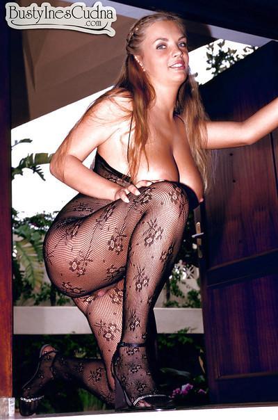 Chesty Euro MILF pornstar Ines Cudna spreading hairy pussy in bodystocking