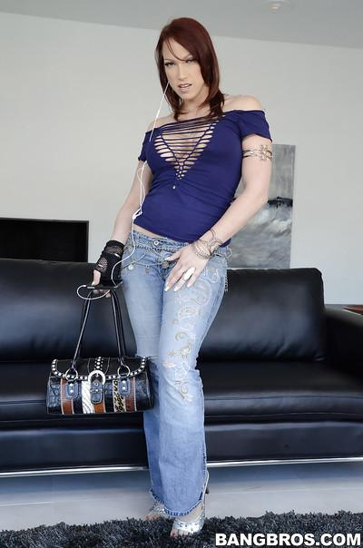 Milf Nicki Hunter in blue jeans demonstrates her wonderful big tits