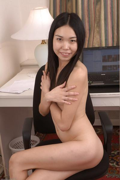 Slippy asian schoolgirl in nylon knee socks undressing and spreading her pussy